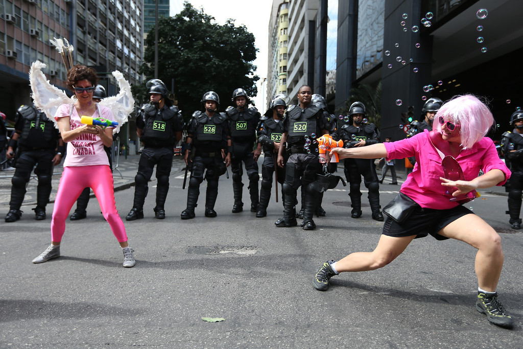 . People protest in front of police during an anti-World Cup demonstration on June 12, 2014 in Rio de Janeiro, Brazil. This is the first day of World Cup play.  (Photo by Joe Raedle/Getty Images)