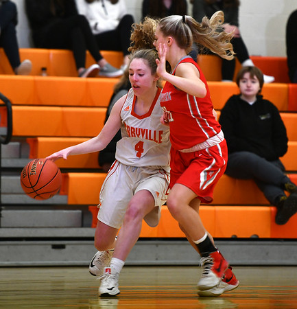 12/26/2019 Mike Orazzi | StaffrTerryville High School's Zoe Zappone (4) and Northwestern's Jana Sanden (23) during Thursday's girls basketball game in Terryville.
