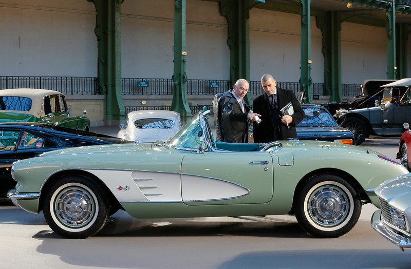 . Visitors look at a Chevrolet Corvette Roadster 1960 at the Grand Palais in Paris, Wednesday, Feb. 6, 2013. The car is expected to fetch between euro 75,000 to 95,000 ($101,50-128,570) at Thursday\'s auction sale. (AP Photo/Jacques Brinon)