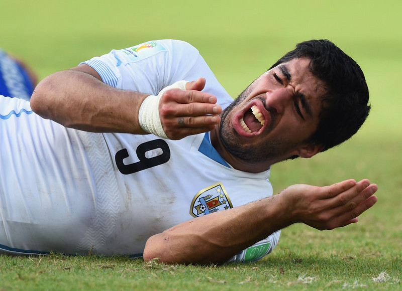 . Luis Suarez of Uruguay reacts during the 2014 FIFA World Cup Brazil Group D match between Italy and Uruguay at Estadio das Dunas on June 24, 2014 in Natal, Brazil.  (Photo by Matthias Hangst/Getty Images)