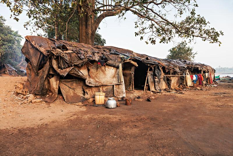 Slum house near the river in India