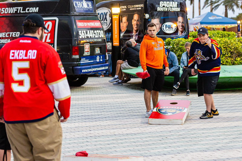 Panther fans play cornhole on the JetBlue tarmac at the BB&T Center in Sunrise before the Florida Panthers hosted the Vancouver Canucks on January 9, 2020. The Panthers would go on to beat the Canucks 5-2. [JOSEPH FORZANO/palmbeachpost.com]