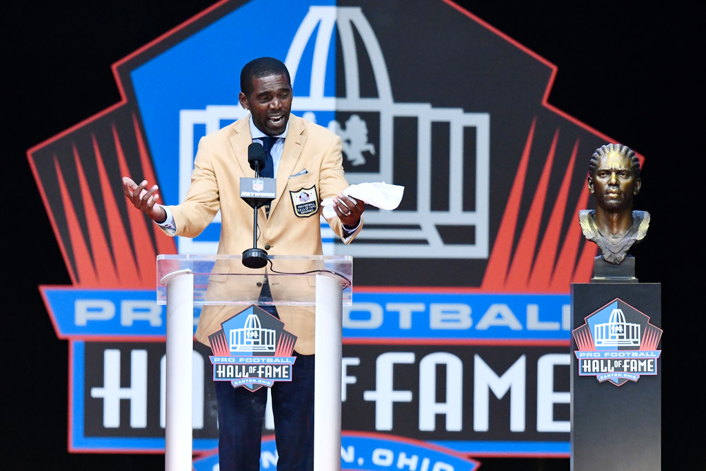 . Former NFL wide receiver Randy Moss delivers his induction speech at the Pro Football Hall of Fame on Saturday, Aug. 4, 2018, in Canton, Ohio. (AP Photo/David Richard)