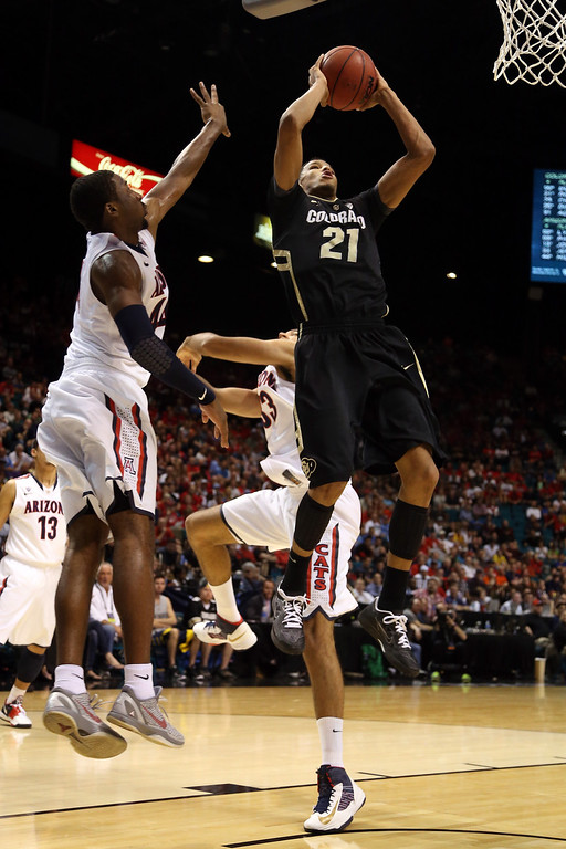 . Andre Roberson #21 of the Colorado Buffaloes goes up for a shot against Solomon Hill #44 of the Arizona Wildcats in the first half during the quarterfinals of the Pac-12 tournament at the MGM Grand Garden Arena on March 14, 2013 in Las Vegas, Nevada.  (Photo by Jeff Gross/Getty Images)