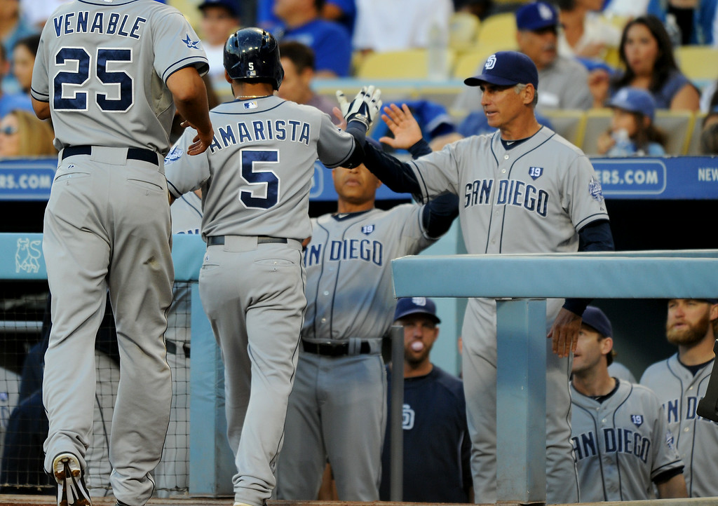 . The Padres Alexi Amarista (#5) is greeted at home by manager Bud Black, right, after a two-run homer in the second inning, Friday, July 11, 2014, at Dodger Stadium. (Photo by Michael Owen Baker/Los Angeles Daily News)