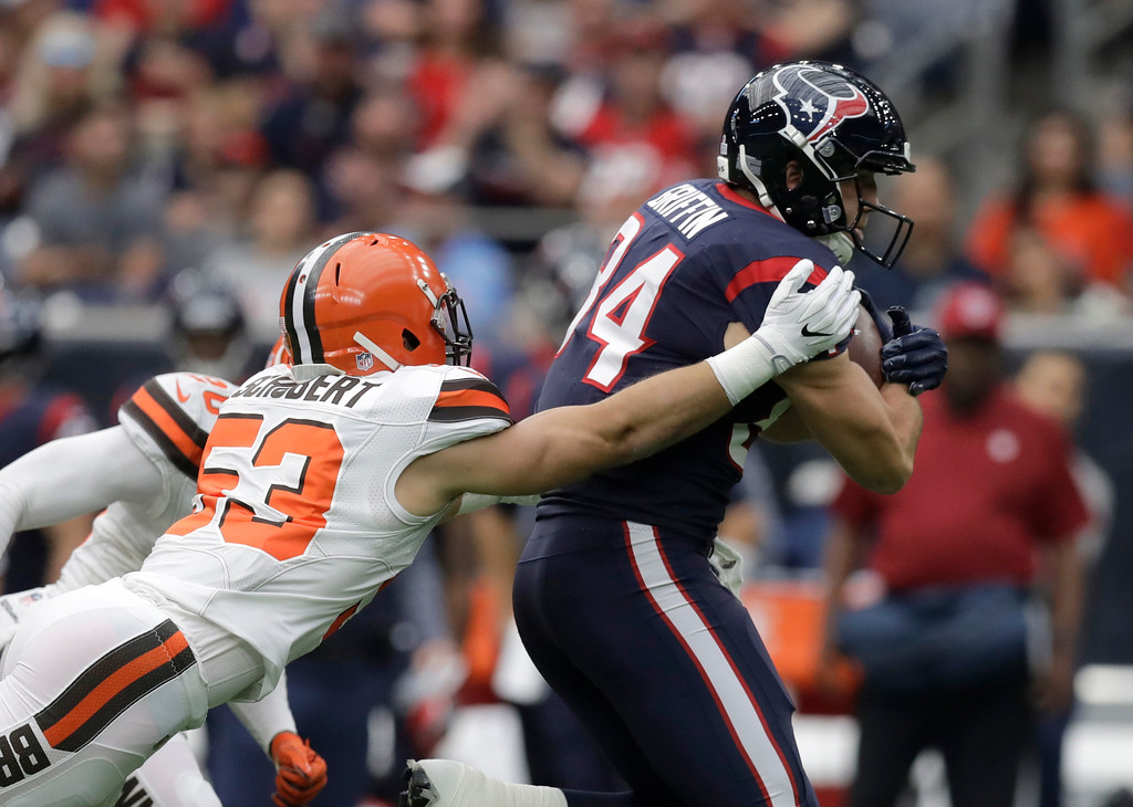 . Cleveland Browns linebacker Joe Schobert (53) attempts to stop Houston Texans tight end Ryan Griffin (84) from gaining yardage after catching a pass in the first half of an NFL football game, Sunday, Oct. 15, 2017, in Houston. (AP Photo/Eric Gay)