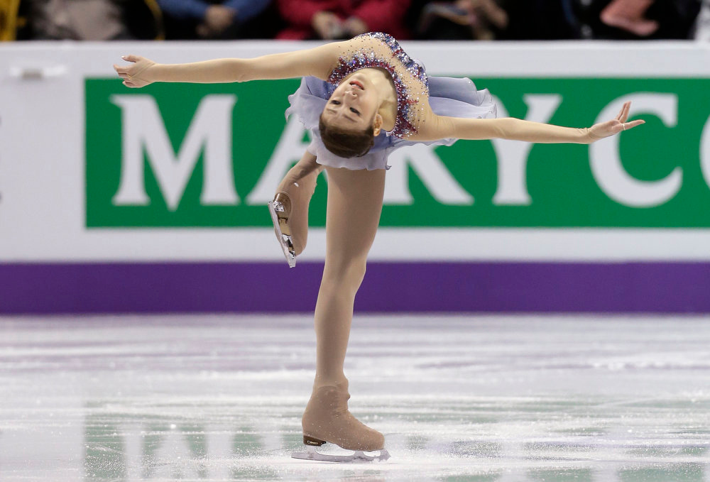 . Kim Yu-na of South Korea performs during the ladies short program at the World Figure Skating Championships Thursday, March 14, 2013, in London, Ontario. (AP Photo/Darron Cummings)