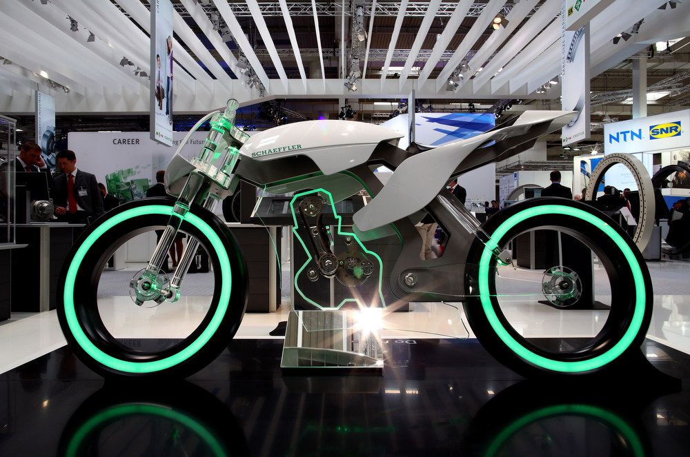 Description of . A motorcycle made of glass is on display at the booth of German company Schaeffler technologies at the industrial trade fair in Hanover, central Germany on April 8, 2013. The fair running from April 8 to 12, 2013 will present a cross section of key industrial technologies.   RONNY HARTMANN/AFP/Getty Images