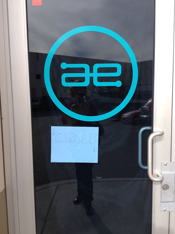 ". On Dec. 2, 2013, a ""closed\"" sign is hung in the door at Always Evolving, the Valencia business owned by Paul Walker and Roger Rodas, who died in a fiery Porsche crash on Nov. 30, 2013. (Photo by Brenda Gazzar/Los Angeles Daily News)"