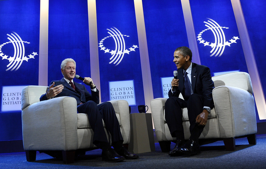 . US President Barack Obama and former President Bill Clinton participate in a conversation about the future of health care reform in America, and the benefits of expanding access to quality health care around the globe at Clinton Global Initiative in New York on September 24, 2013. JEWEL SAMAD/AFP/Getty Images