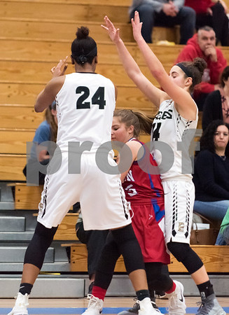 02/20/18 Wesley Bunnell   Staff Berlin girls basketball was defeated 80-50 by Enfield at Glastonbury High School on Tuesday night during the CCC tournament. Carly Grega (15) is double teamed by Mary Baskerville and Caterina Fonseca (14).