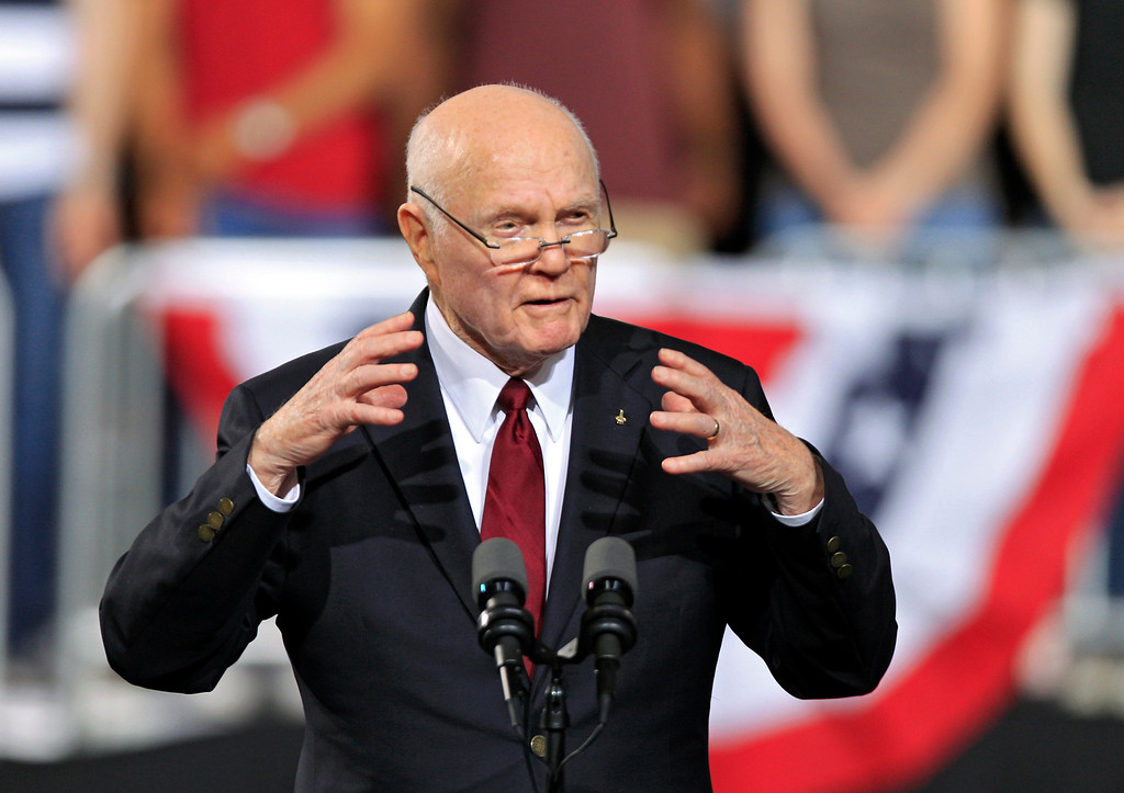 . FILE - This May 5, 2012 file photo shows former astronaut and former Ohio Sen. John Glenn speaking before a campaign rally for President Barack Obama at The Ohio State University in Columbus, Ohio. Whatever their political beliefs, some artists perform an age-old ritual: warming up the crowd before a political rally, generating enthusiasm and all-important buzz for events that otherwise could be overlooked in a crowded news cycle. For politicians _ even those as well known as Obama and Republican presidential candidate, former Massachusetts Gov. Mitt Romney _  celebrity warm-up acts can provide validation by taking them out of the political realm into popular culture, said Darrell West, director of governance studies at the Brookings Institution think tank in Washington. (AP Photo/Mark Duncan, File)