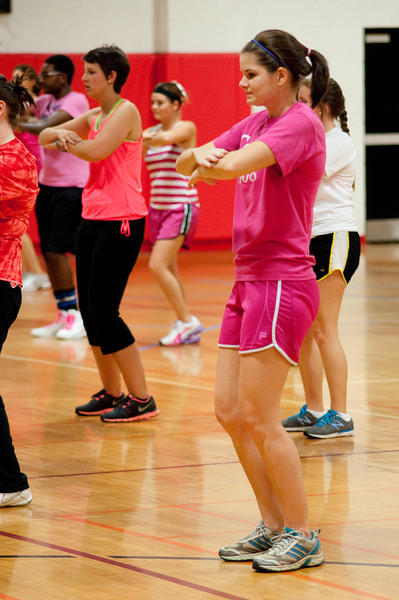 Sarah Beth Anthony dances along with the instructor during Party for the Cure Sunday night in Bost Gym.