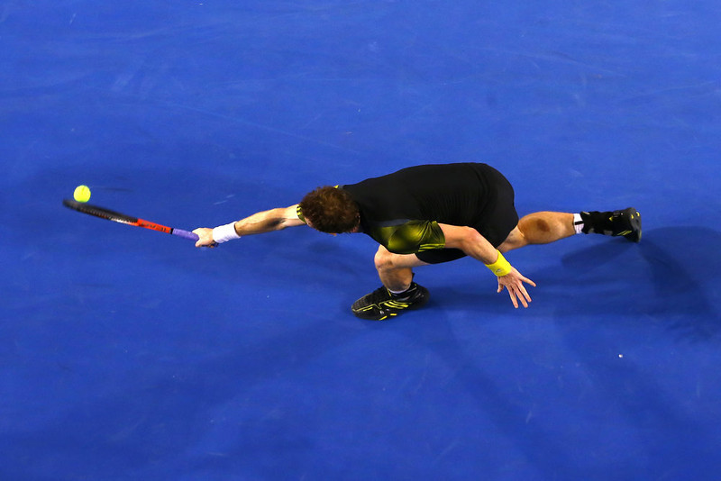 . Andy Murray of Great Britain plays a backhand in his men\'s final match against Novak Djokovic of Serbia during day fourteen of the 2013 Australian Open at Melbourne Park on January 27, 2013 in Melbourne, Australia.  (Photo by Ryan Pierse/Getty Images)