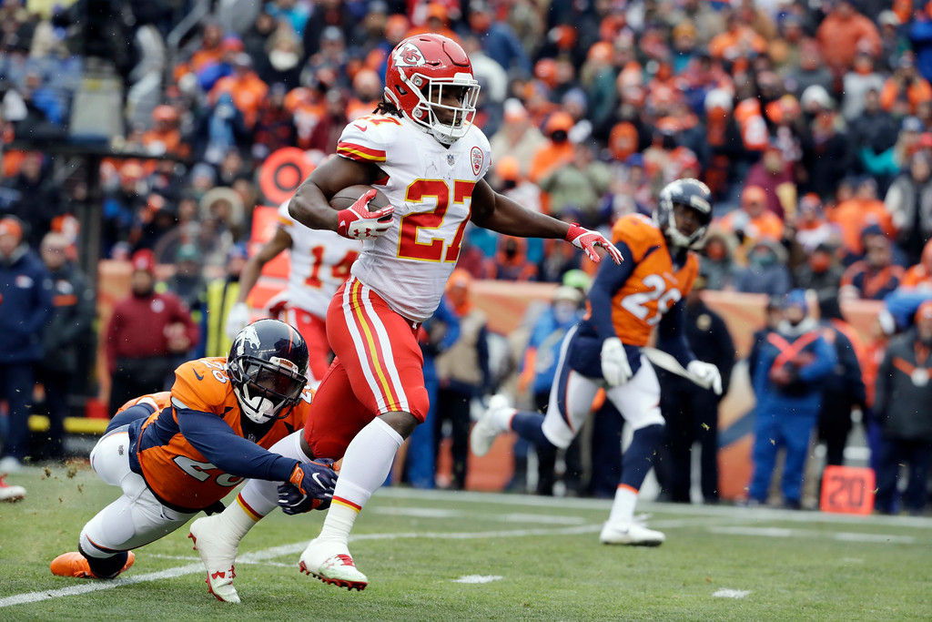 . Kansas City Chiefs running back Kareem Hunt (27) runs for a touchdown past the tackle attempt from Denver Broncos free safety Darian Stewart, bottom left, during the first half of an NFL football game, Sunday, Dec. 31, 2017, in Denver. (AP Photo/Joe Mahoney )