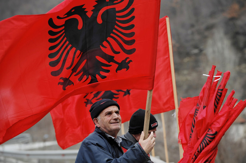 . Kosovo Albanians place Albanian flags on a bridge near the town of Kacanik on February 16, 2013, in preparation for the fifth anniversary of Kosovo\'s declaration of independence. On February 17, Kosovo will mark the second anniversary of its unilateral declaration of independence from Serbia. Kosovo, an ethnic Albanian-majority province of Serbia, proclaimed independence unilaterally on February 17, 2008 in a Western-backed move seen as the final chapter in the bloody breakup of Yugoslavia. ARMEND NIMANI/AFP/Getty Images