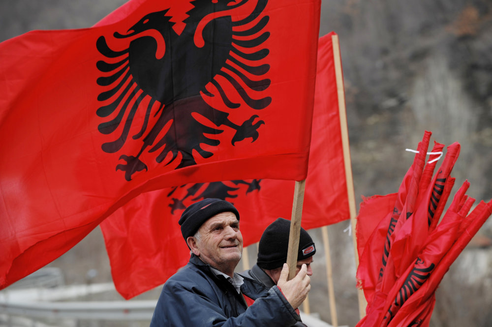 Description of . Kosovo Albanians place Albanian flags on a bridge near the town of Kacanik on February 16, 2013, in preparation for the fifth anniversary of Kosovo's declaration of independence. On February 17, Kosovo will mark the second anniversary of its unilateral declaration of independence from Serbia. Kosovo, an ethnic Albanian-majority province of Serbia, proclaimed independence unilaterally on February 17, 2008 in a Western-backed move seen as the final chapter in the bloody breakup of Yugoslavia. ARMEND NIMANI/AFP/Getty Images