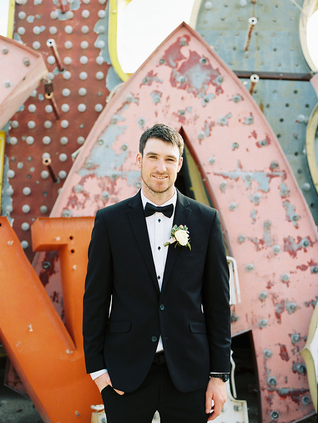 The Neon Museum - a colorful Las Vegas wedding venue //  Kristen Krehbiel - Kristen Kay Photography // #blacktux #groom #classic