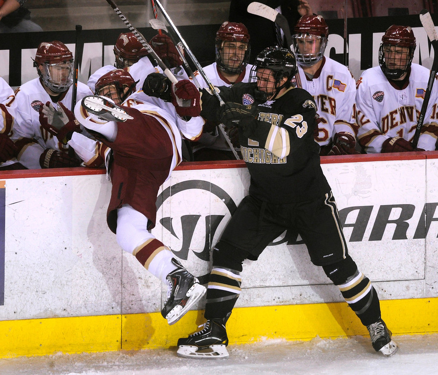 . DENVER, CO. - NOVEMBER 16: Western Michigan wing Aaron Hadley (23) tried to put Denver wing Daniel Doremus back on the bench in the second period. The University of Denver hockey team hosted Western Michigan at Magness Arena Saturday night, November 16, 2013.  Photo By Karl Gehring/The Denver Post