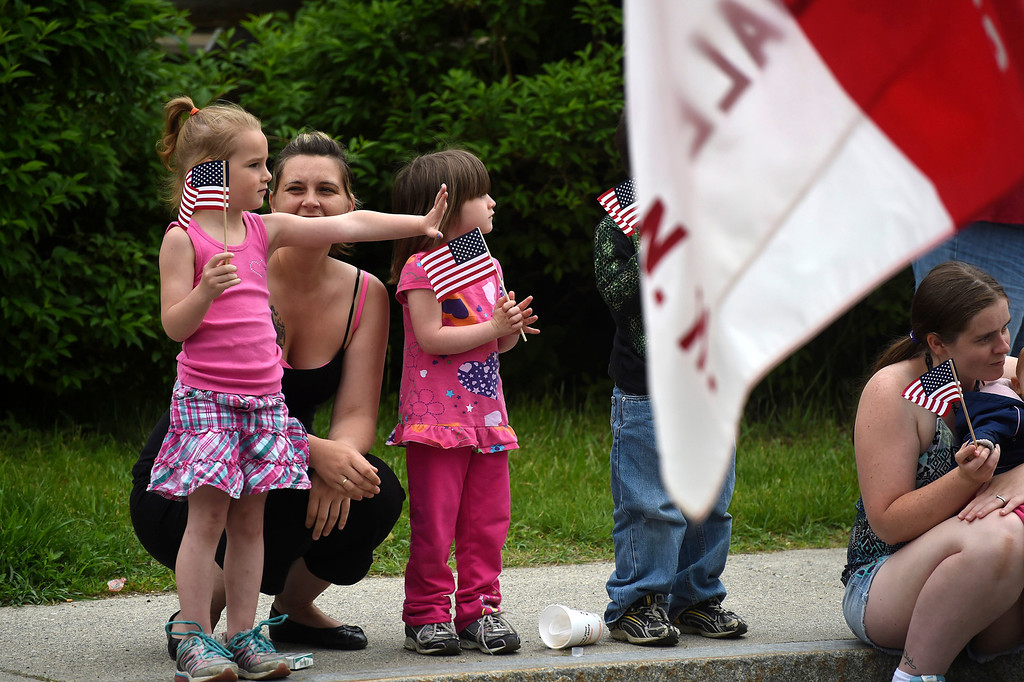 . Kayla Rice/Reformer Rebecca Paligo of Brattleboro stands with her daughter and niece Hayla and Maddison Paligo, both 4, while watching the Hinsdale Memorial Day parade on Monday morning.