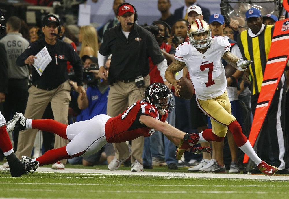 Description of . San Francisco 49ers quarterback Colin Kaepernick (R) scrambles under pressure from Atlanta Falcons defensive end Kroy Biermann during the second quarter in the NFL NFC Championship football game in Atlanta, Georgia January 20, 2013. REUTERS/Chris Keane