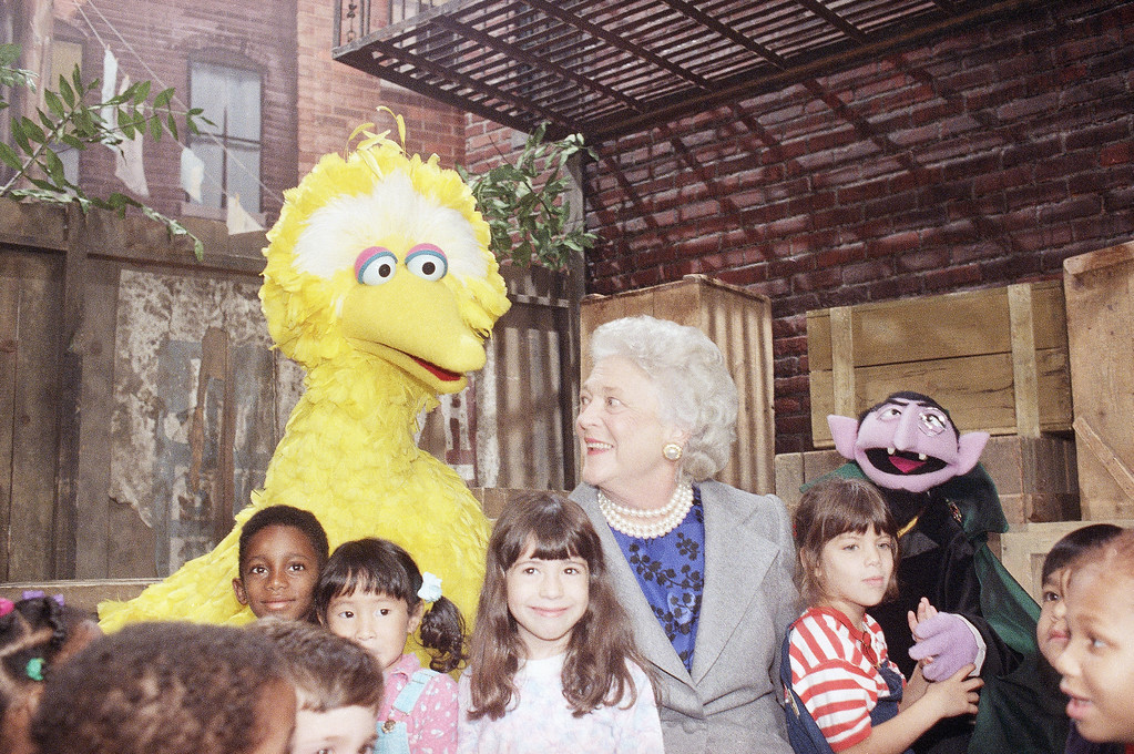 """. First lady Barbara Bush chats with Big Bird and several children while taping a special segment of PBS\' """"Sesame Street"""" for its 21st season, Oct. 19, 1989 at the Children\'s Television Workshop in New York. The new season begins November 13. (AP Photo/Mark Lennihan)"""