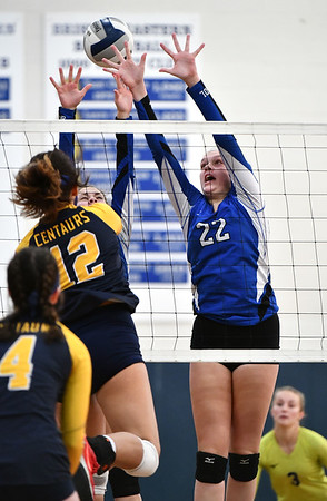 11/16/2019 Mike Orazzi | StaffrBristol Easterns Hannah Webber (22) Woodstock Academy's Paula Hernandez Aulet (12) during the 2019 State Girls Volleyball Tournament Class L Quarterfinals at BEHS in Bristol Saturday. r