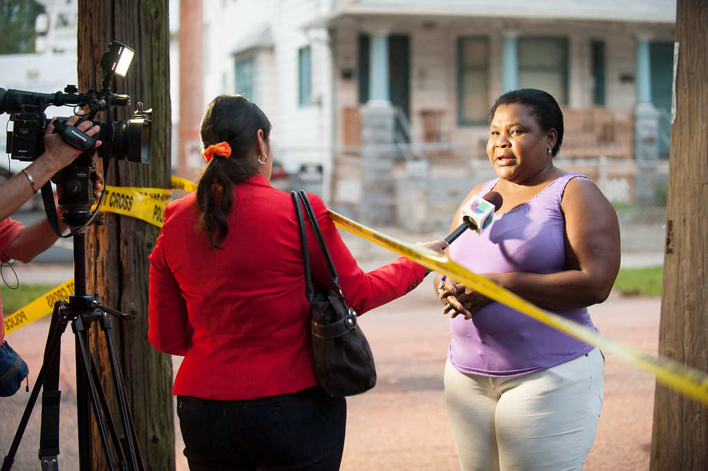. CLEVELAND, OH - AUGUST 7: An unidentified woman speaks to a reporter oustide the home of Ariel Castro on August 7, 2013 in Cleveland, Ohio. Castro, who held 3 women captive for a decade, has committed suicide, Tuesday, Sept. 3, 2013. Castro was found guilty of absucting three women between 2002 and 2004 and holding them captive in his home on Seymour Street. Castro was sentenced to life in prison with no parole plus one thousand years. (Photo by Angelo Merendino/Getty Images)