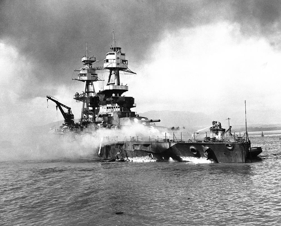 . In this image provided by the U.S. Navy, crewmen of the USS Nevada still fight flames on the battleship, battered in the Japanese aerial attack on Pearl Harbor on Dec. 7, 1941, after the big ship is beached at Hospital Point. (AP Photo/U.S. Navy)