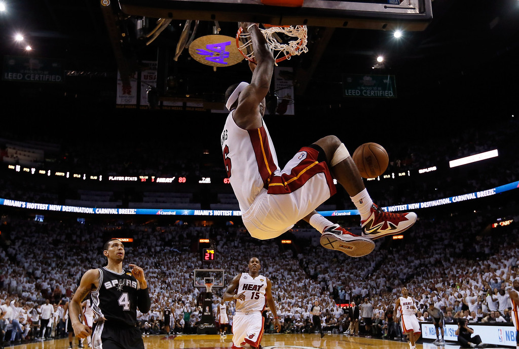. LeBron James #6 of the Miami Heat dunks the ball in the fourth quarter while taking on the San Antonio Spurs during Game Two of the 2013 NBA Finals at AmericanAirlines Arena on June 9, 2013 in Miami, Florida.   (Photo by Christian Petersen/Getty Images)