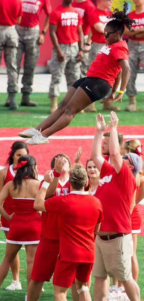 Another cheerleader doing her dismounts.