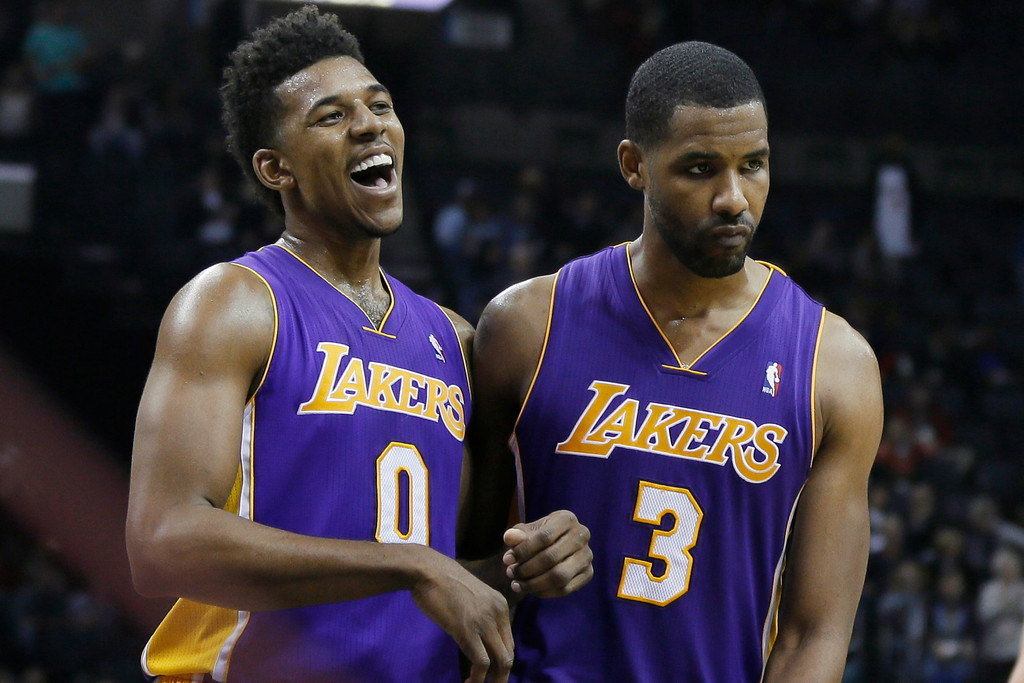 . Los Angeles Lakers\' Nick Young (0) and Shawne Williams (3) walk off the court after an NBA basketball game against the Memphis Grizzlies in Memphis, Tenn., Tuesday, Dec. 17, 2013. The Lakers defeated the Grizzlies 96-92. (AP Photo/Danny Johnston)