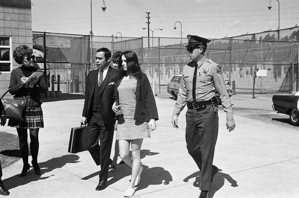 . Susan Denise Atkins is accompanied by her attorney, Richard Caballero, as she arrives at the Los Angeles County Jail for her first face-to-face meeting with Charles Manson since she and Manson and others of his hippie-style group were charged with multiple murders, March 5, 1970. Manson, acting as his own attorney, had asked to question Ms. Atkins, whose testimony led to grand jury indictments of the group. (AP Photo)