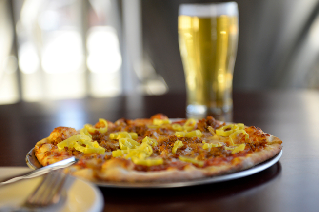 . LowDown Brewery & Kitchen recently opened it\'s doors in Denver, April 24, 2014. One of the restaurant\'s specialty pizzas is called the LowDown pizza. (Photo by RJ Sangosti/The Denver Post)
