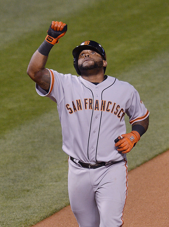 . Giants slugger Pablo Sandoval gestured after his single shot home run in the sixth inning. The Colorado Rockies hosted the San Francisco Giants Wednesday night, May 21, 2014.  (Photo by Karl Gehring/The Denver Post)