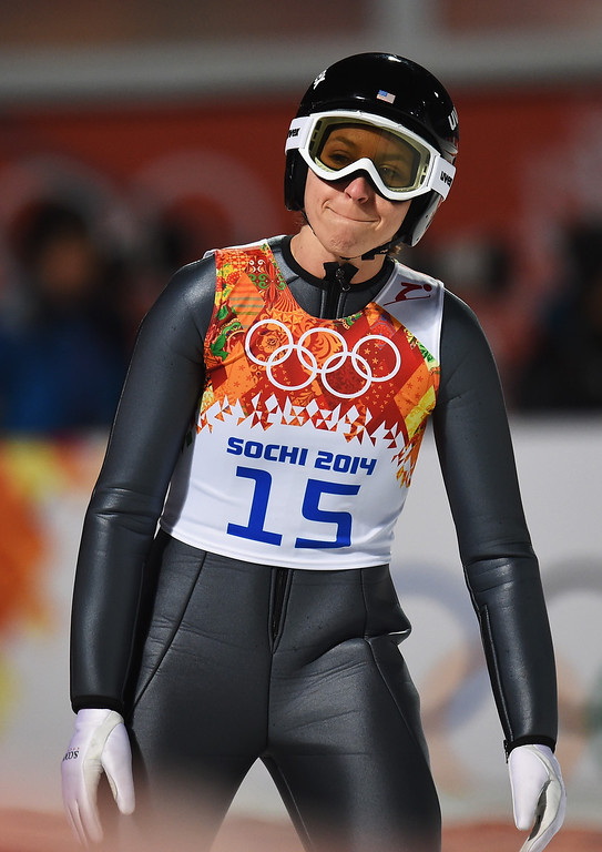 . Jessica Jerome of the United States reacts after jumping during the Ladies\' Normal Hill Individual final round on day 4 of the Sochi 2014 Winter Olympics at the RusSki Gorki Ski Jumping Center on February 11, 2014 in Sochi, Russia.  (Photo by Lars Baron/Getty Images)