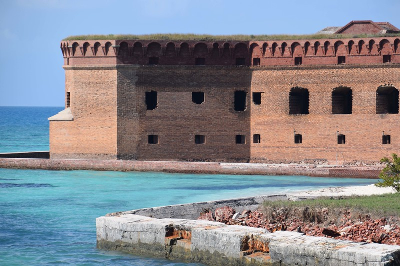 The brick exterior of Fort Jefferson surrounded by Gulf of Mexico.