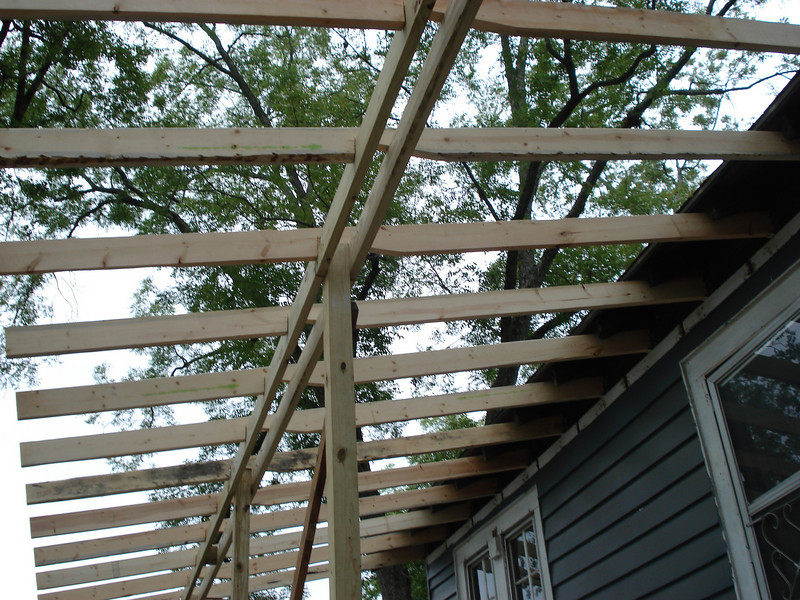Frame of new porch roof almost up. ck