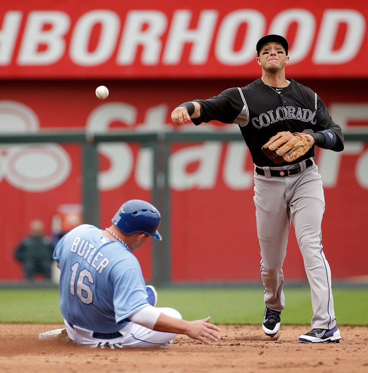 . Colorado Rockies shortstop Troy Tulowitzki throws to first after forcing Kansas City Royals\' Billy Butler (16) out at second on a single by Alex Gordon during the third inning of a baseball game Wednesday, May 14, 2014 in Kansas City, Mo. (AP Photo/Charlie Riedel)