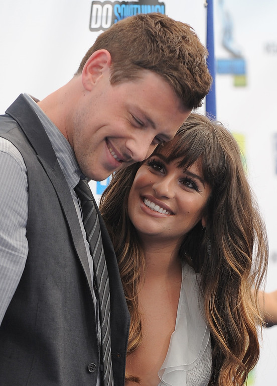 """. This Aug. 19, 2012 file photo shows Cory Monteith, left, and Lea Michele at the 2012 Do Something awards in Santa Monica, Calif.  Monteith, who shot to fame in the hit TV series \""""Glee\"""" but was beset by addiction struggles so fierce that he once said he was lucky to be alive, was found dead in a Vancouver hotel room, police said.  (Photo by Jordan Strauss/Invision/AP, File)"""
