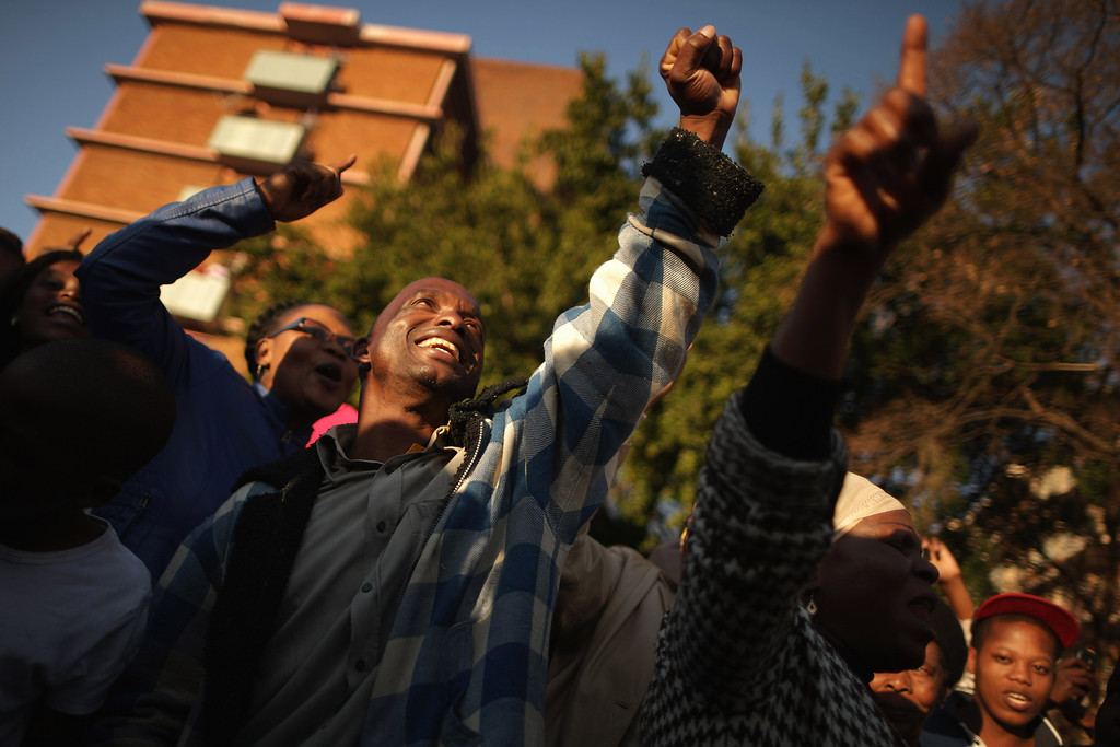 . PRETORIA, SOUTH AFRICA - JUNE 25:  A large crowd of supporters sing songs of support outside of the Mediclinic Heart Hospital where former South African President Nelson Mandela is being treated June 25, 2013 in Pretoria, South Africa. South African President Jacob Zuma confirmed on June 23 that Mandela\'s condition has become critical since he was admitted to the hospital over two weeks ago for a recurring lung infection.  (Photo by Chip Somodevilla/Getty Images)