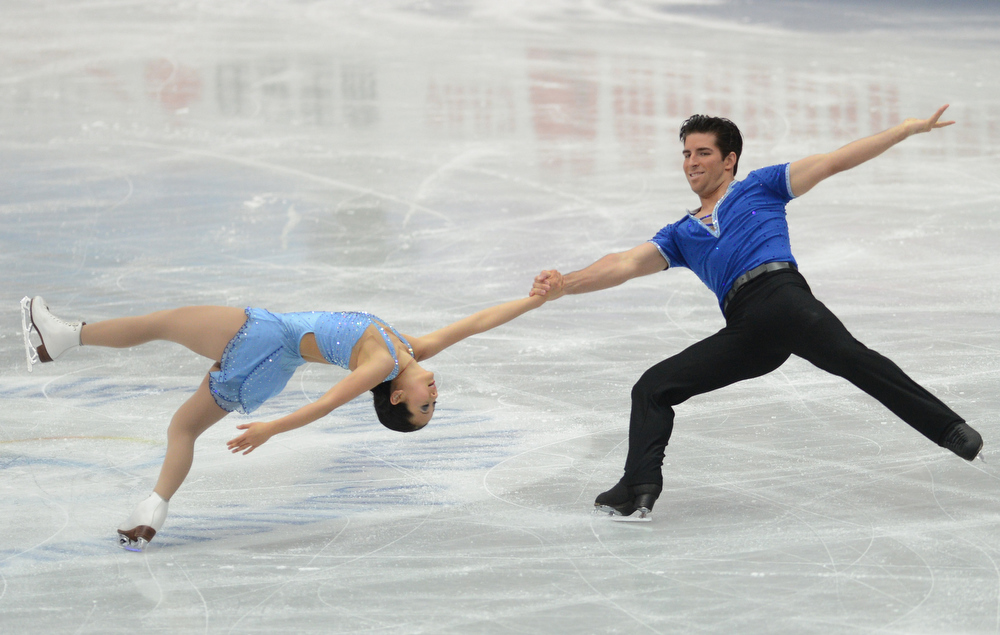 Description of . Felicia Zhang and Nathan Bartholomay of USA skate in the Pairs Short Program during day one of the ISU Four Continents Figure Skating Championships at Osaka Municipal Central Gymnasium on February 8, 2013 in Osaka, Japan.  (Photo by Atsushi Tomura/Getty Images)