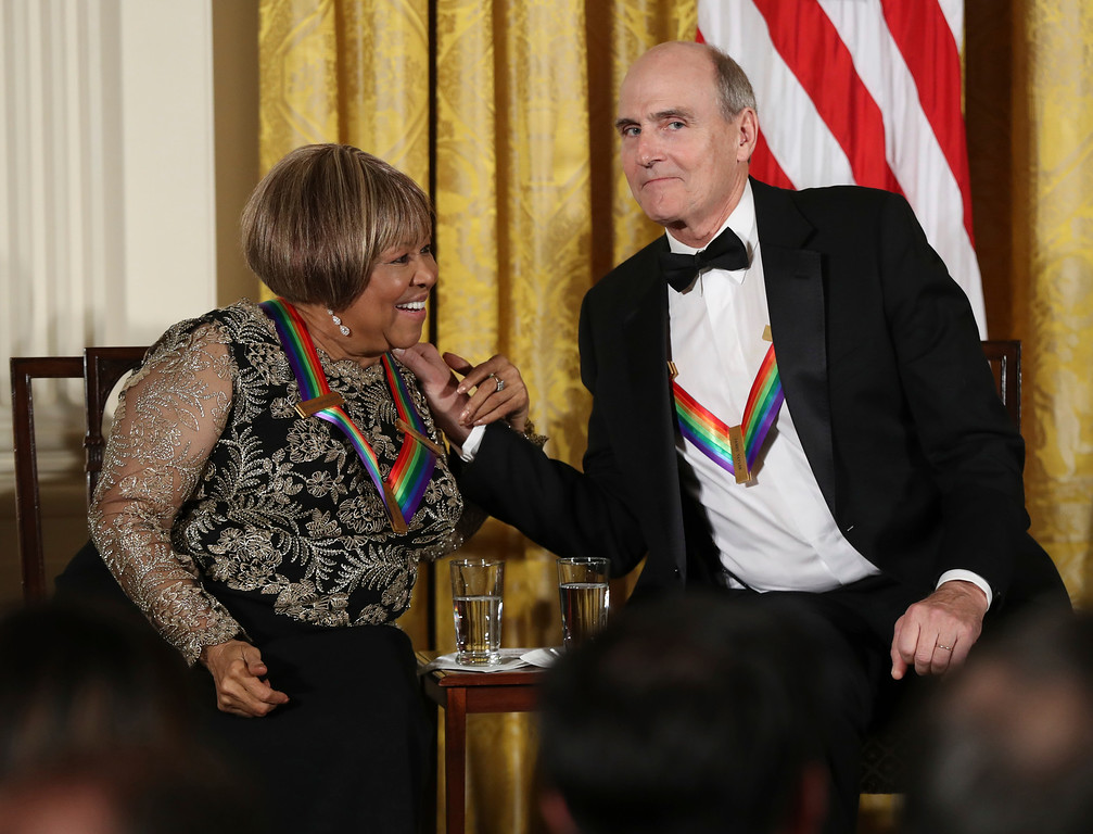 . Recipients of the 2016 Kennedy Center Honors gospel and blues singer Mavis Staples and musician James Taylor, hold hands during a reception in their honor in the East Room of the White House in Washington, Sunday, Dec. 4, 2016, hosted by President Barack Obama and first lady Michelle Obama. (AP Photo/Manuel Balce Ceneta)