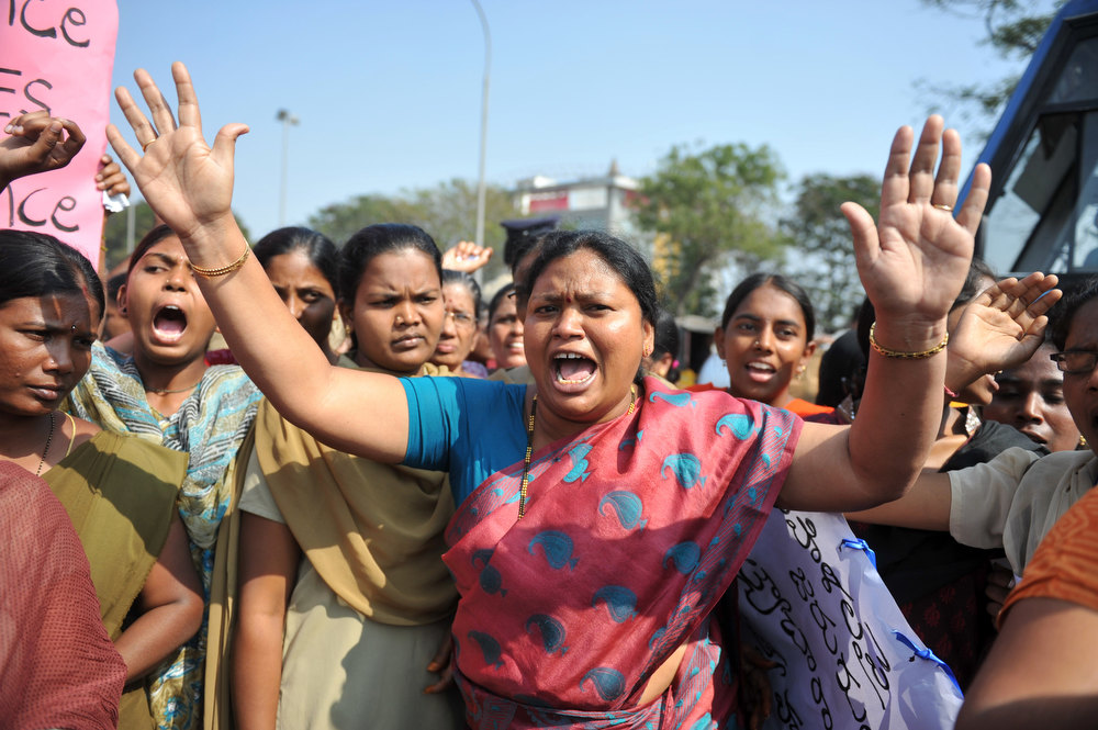 . Indian students of various organisations hold placards as they shout slogans during a demonstration in Hyderabad on January 3, 2013.   A gang of men accused of repeatedly raping a 23-year-old student on a moving bus in New Delhi in a deadly crime that repulsed the nation are to appear in court for the first time. Police are to formally charge five suspects with rape, kidnapping and murder after the woman died at the weekend from the horrific injuries inflicted on her during an ordeal that has galvanised disgust over rising sex crimes in India.   NOAH SEELAM/AFP/Getty Images
