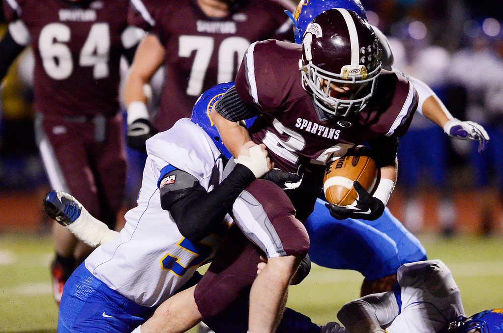 . Erica Miller - The Saratogian @togianphotog      Burnt Hills-Ballston Lake\'s Joshua Quesada carried the ball down the field against Queensbury\'s Taylor Wilson for the Section 2 Class A Superbowl Saturday evening Nov. 9, 2013.SAR-l-footballs3