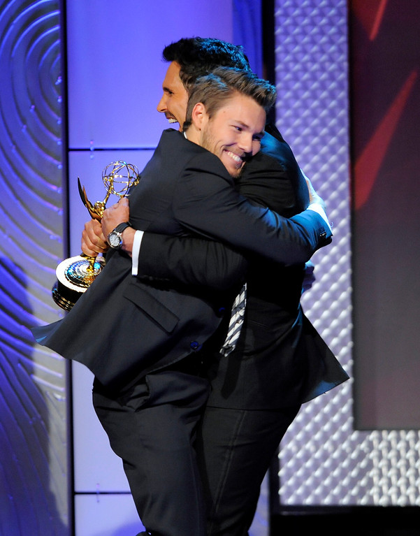 """. Scott Clifton, left, from the cast of \""""The Bold and the Beautiful,\"""" is congratulated by Don Diamont, after Clifton won the award for outstanding supporting actor in a drama series at the 40th Annual Daytime Emmy Awards on Sunday, June 16, 2013, in Beverly Hills, Calif. Don Diamont presented the award. (Photo by Chris Pizzello/Invision/AP)"""