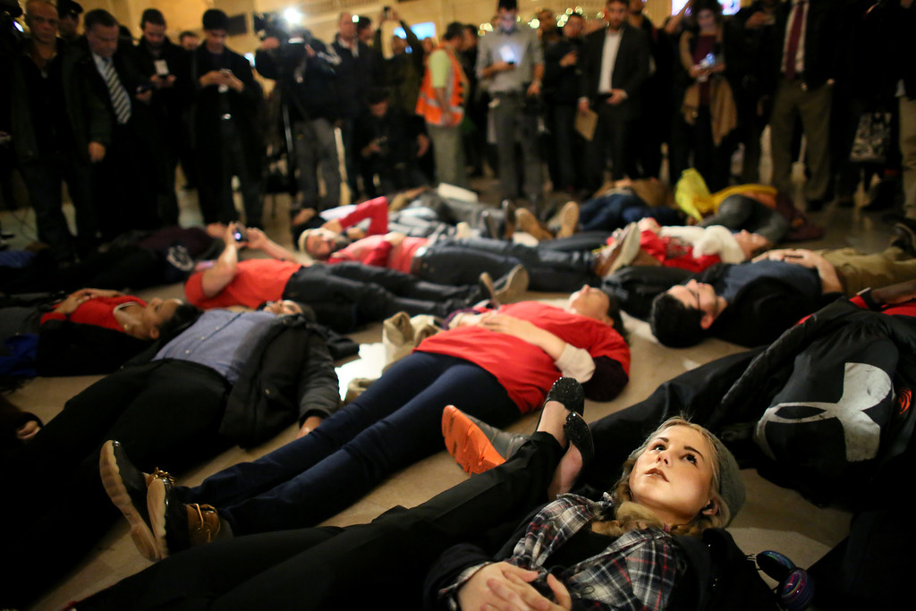 . LIndsey Ellefson, 22, lies down during a protest in Grand Central Terminal December 3, 2014 in New York. Protests began after a Grand Jury decided to not indict officer Daniel Pantaleo. Eric Garner died after being put in a chokehold by Pantaleo on July 17, 2014. Pantaleo had suspected Garner of selling untaxed cigarettes. (Photo by Yana Paskova/Getty Images)