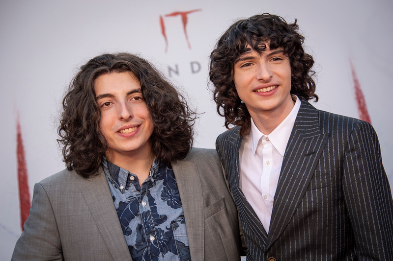"WESTWOOD, CA - AUGUST 26: Finn Wolfhard (R) and his brother Nick Wolfhard attend the Premiere Of Warner Bros. Pictures' ""It Chapter Two"" at Regency Village Theatre on Monday, August 26, 2019 in Westwood, California. (Photo by Tom Sorensen/Moovieboy Pictures)"