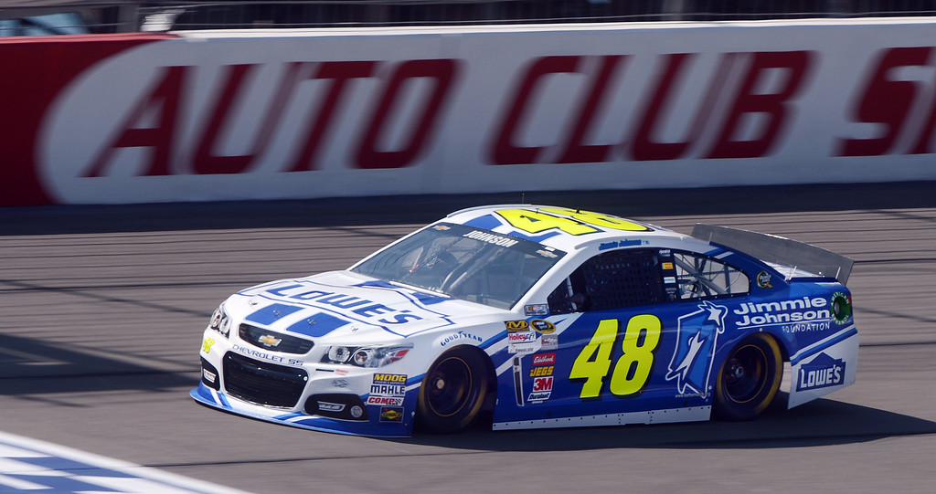 . (Will Lester/Staff Photographer) NASCAR driver Jimmie Johnson races down the front straightaway during the opening practice session for Sunday\'s Auto Club 400 Friday March 22, 2013.