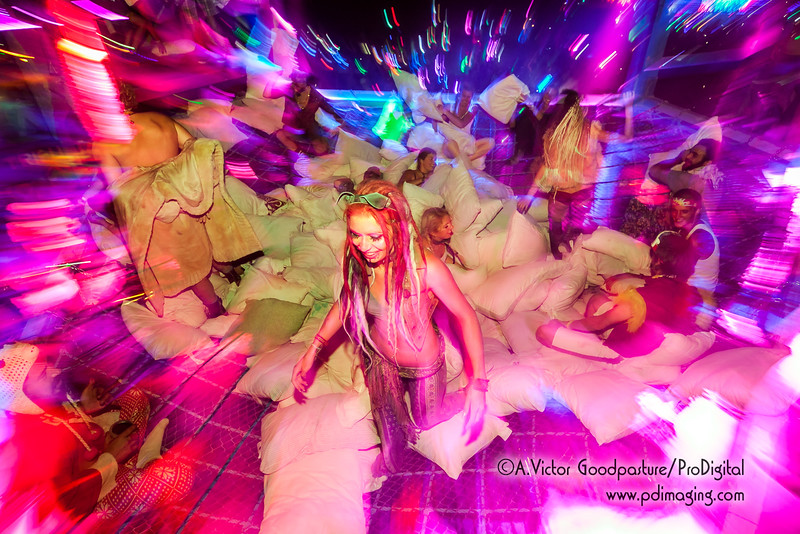 A giant pillow-fighting pit suspended over a dance floor...... who comes up with this???